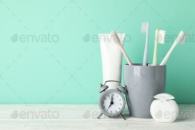 Tools for dental care on mint background, space for text