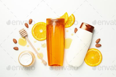 Flat lay with cosmetics and natural ingredients on white background