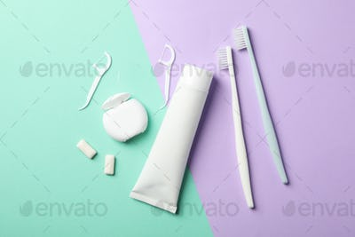 Tools for dental care on two tone background, top view