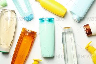 Blank bottles of cosmetics on white background