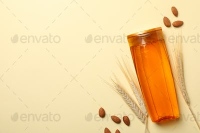 Composition with shampoo bottle on beige background, space for text