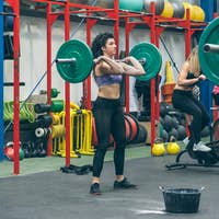Woman practicing weightlifting in the gym