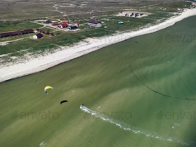 kitesurfer in action aerial view from drone