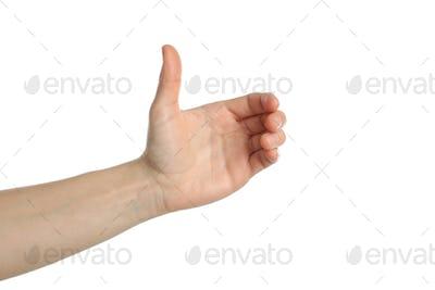 Female hand holding something, isolated on white background