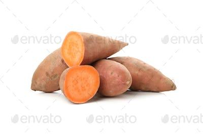 Heap of sweet potato isolated on white background