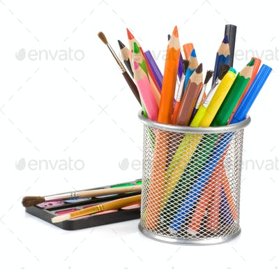 holder basket with pencils and paint