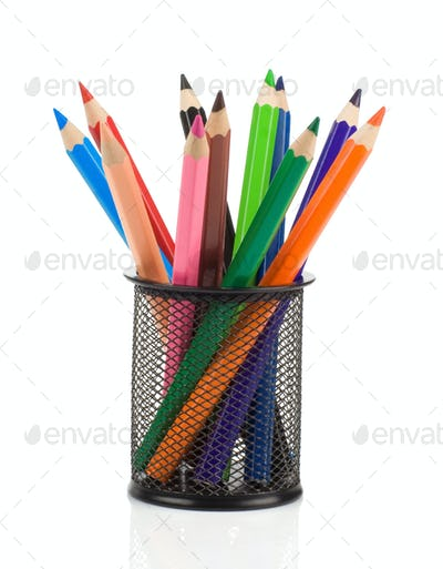 colorful pencils in holder basket on white