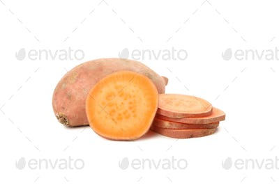Sweet potato and slices isolated on white background