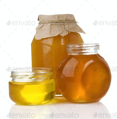 pot of honey and jar isolated on white