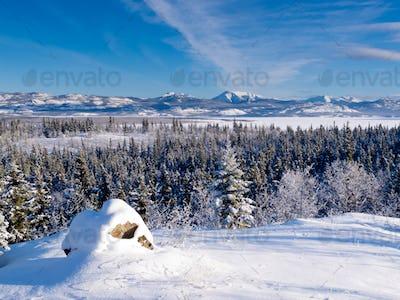 Scenic winter at frozen Lake Laberge Yukon Canada