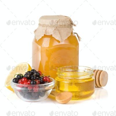 glass jar full of honey, lemon and berry