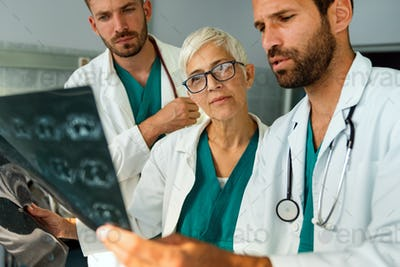 Radiologist doctor consulting with colleagues an x-ray scan in hospital