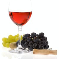 wine in glass and grape fruit