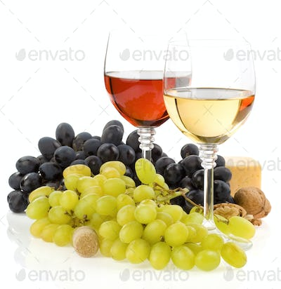 wine in glass and fruit isolated on white