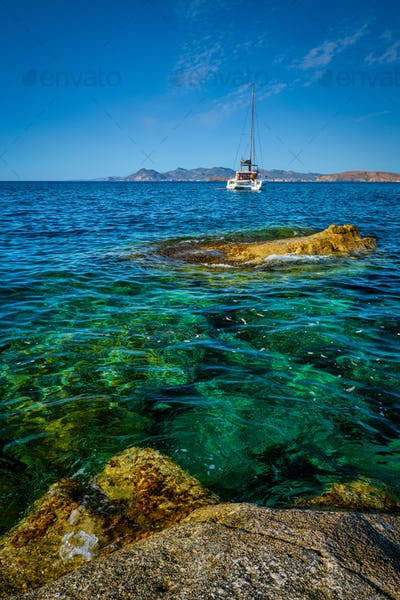 Yacht boat at Sarakiniko Beach in Aegean sea, Milos island , Greece