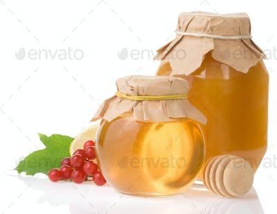 jar of honey and fruit isolated on white