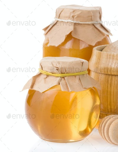 honey jar and pot isolated on white