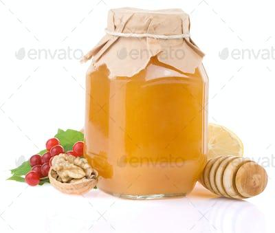 glass jar full of honey and fruit