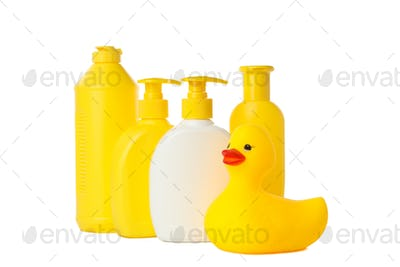 Bathroom bottles and rubber duck isolated on white background