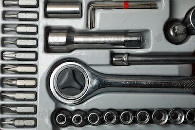 Mechanic tools kit on whole background, close up