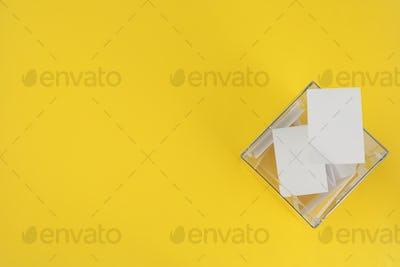 Voting box with bulletins on yellow background, space for text