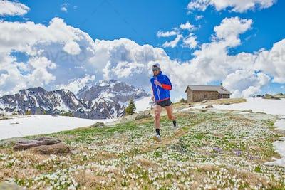 Athlete runner among the crocus flowers