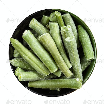 top view of frozen green beans in round bowl
