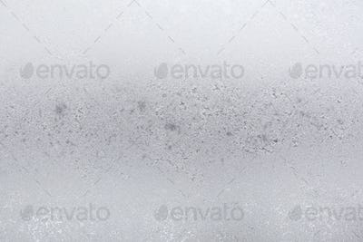 frost on surface of home window in urban houses