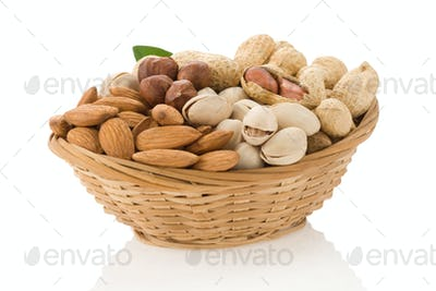 set of nuts in bowl isolated on white