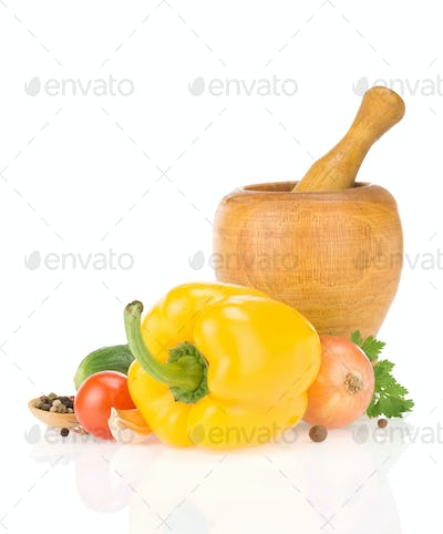 mortar with pestle and spices vegetable isolated on white
