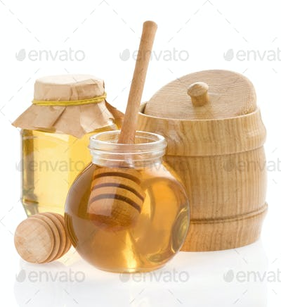 jar of honey and wood stick on white