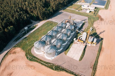 Aerial View Modern Granary, Grain-drying Complex, Commercial Grain Or Seed Silos In Sunny Spring