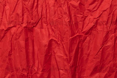 Red crumpled paper texture, grunge background