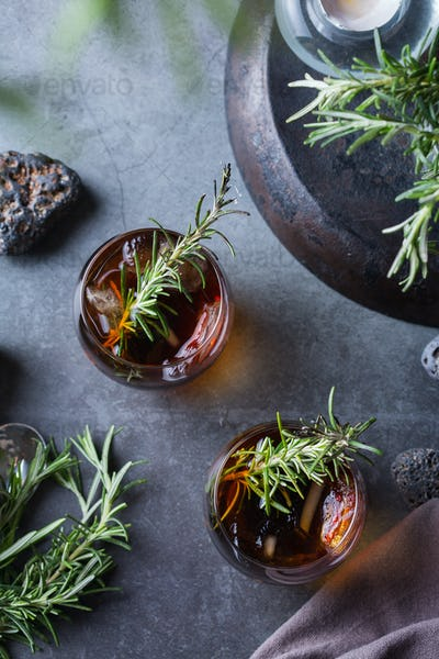 Smoked rosemary old fashioned cocktail on a table