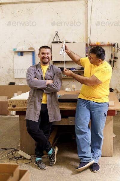 Carpenters team portrait in their workshop
