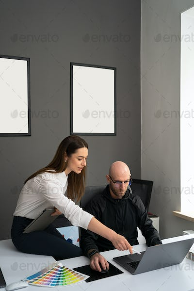 Two colleagues discussing new information about products