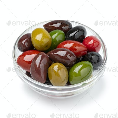 Glass bowl with a variation of different olives on white background