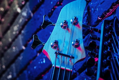 Guitar headstock with tuners on dark background