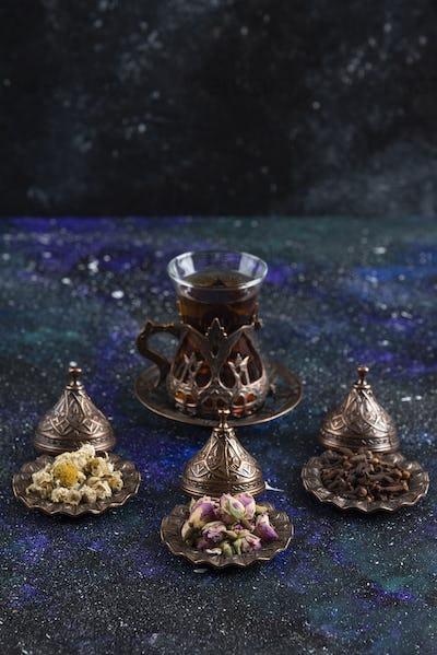 Vertical photo of Fragrant tea behind of various herbs