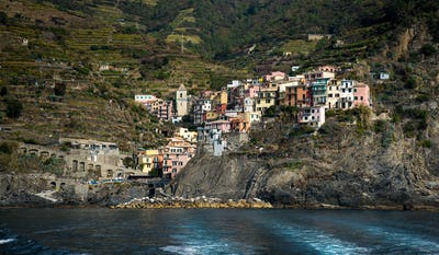 Village of vernazza with colourful houses at the edge of the cliff Riomaggiore, Cinque Terre