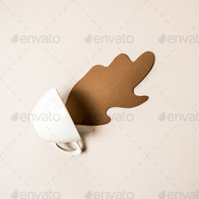 White Mug with spilled paper coffee. Space for text, top view