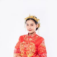 Woman wear Cheongsam suit and crown give gold to her family for lucky in chinese new year