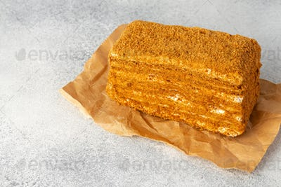 Piece of honey cake on kitchen table