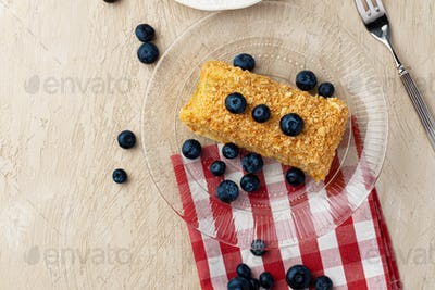 Piece of russian honey cake medovik served with berries
