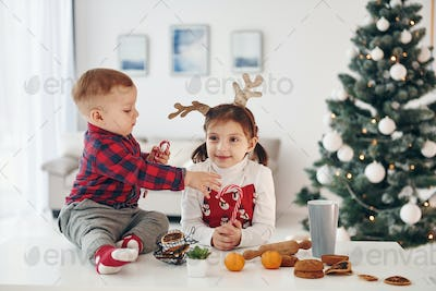 Little brother with her daughter celebrates New year and christmas at home