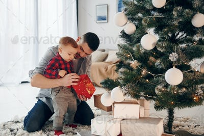 Father with his little son celebrates New year and christmas together