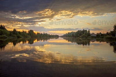 Gorgeous sunset over lake, water as a mirror, golden hours, twilight, local travel and nature