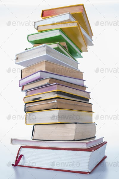 pile of colored different books on white table