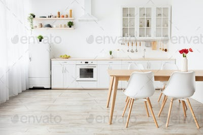 Minimalist kitchen design in scandinavian style. Dining table with tulips and furniture with