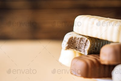 Still life of chocolate popsicle lying on a plate on a wooden background table. Copy space